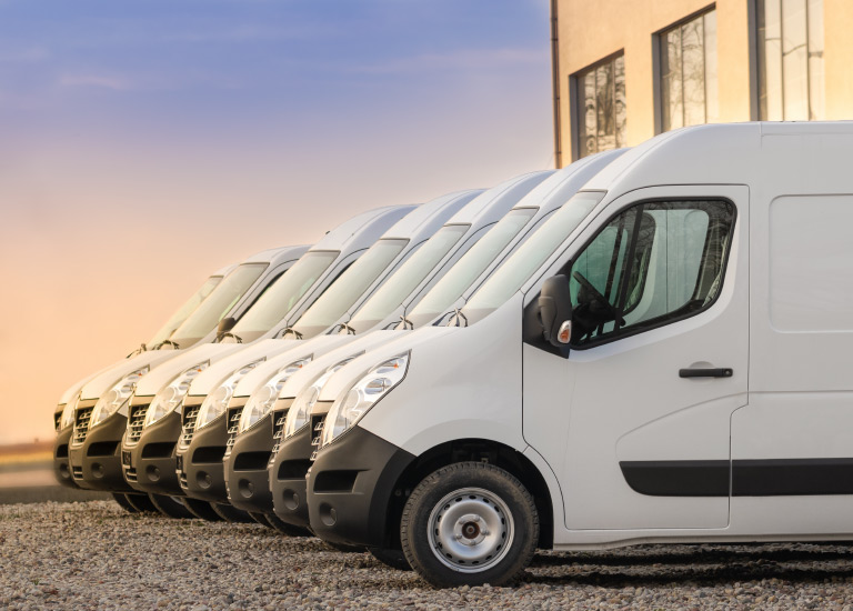 commercial vehicle insurance white vans parked
