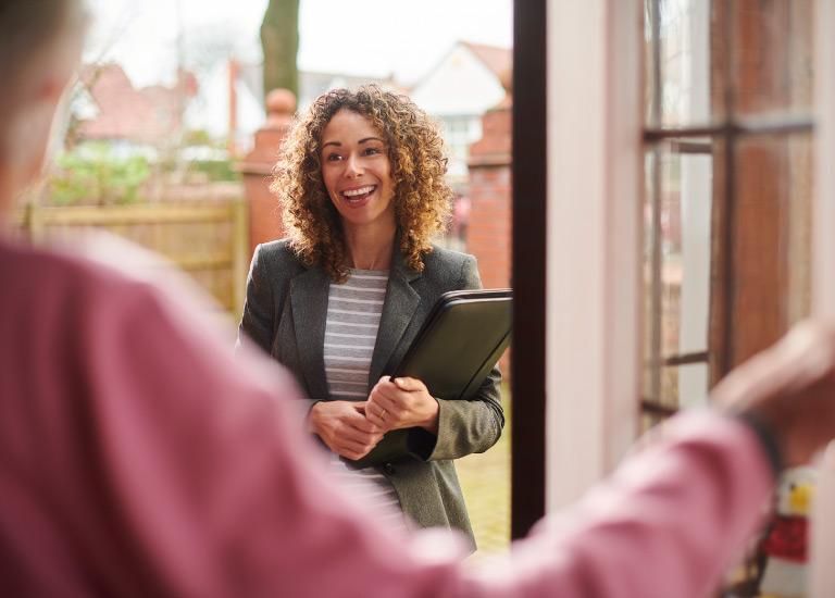 rented dwelling insurance person greeting renter